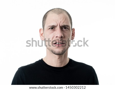 Close up portrait of young man with confused face thinking with a pensive expression looking Puzzled and doubtful. Isolated on white background, in People and human emotions and facial expressions. #1450302212