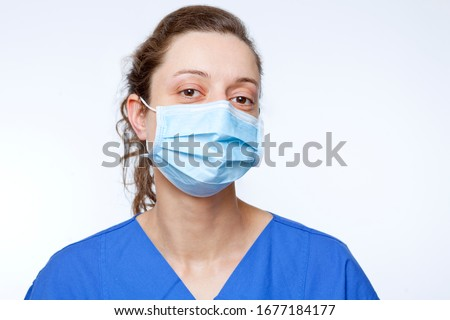 close up portrait of young nurse with mouthpiece mouth protection surgical face mask medical protective mask respirator Сток-фото ©