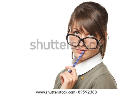 Close-up portrait of young pensive female wearing old fashioned eyeglasses looking up, isolated on white background