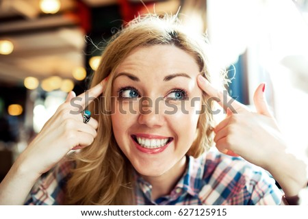 Close up portrait of young smart successful female smiling, woman funny emotions.