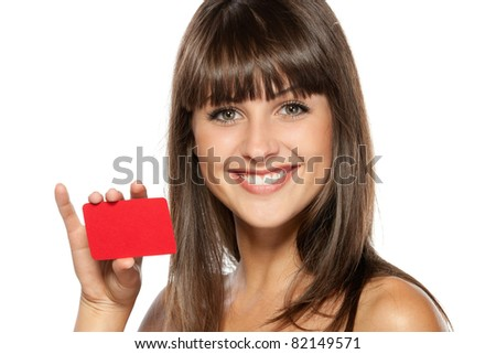 Close-up portrait of young smiling female holding credit card isolated on white background