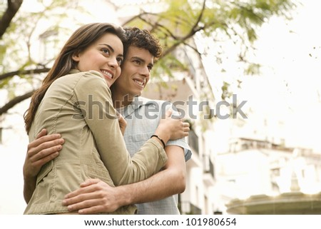 Close up portrait of young tourist couple visiting a town.