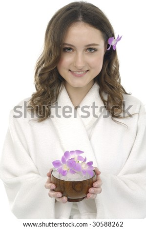 Close up portrait of young woman holding bowel of flower