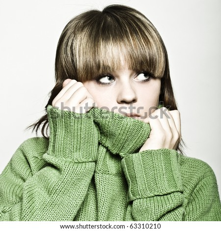 close up portrait of young woman in green sweater