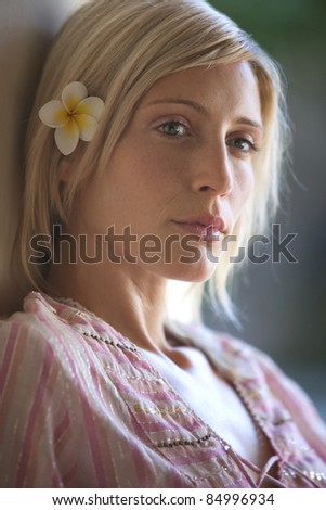 Close up portrait of young woman in holiday villa, relaxing.