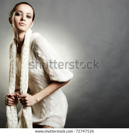 close up portrait of young woman in white sweater