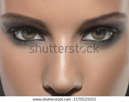 Close-up portrait of young woman's eyes