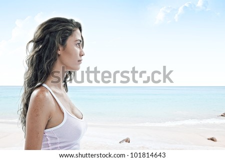 close up portrait of young woman walking through the empty  beach