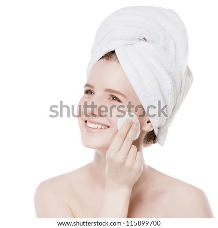 Close-up portrait of young woman with perfect health skin of face, bath towel on head and clean sponge. Isolated on white