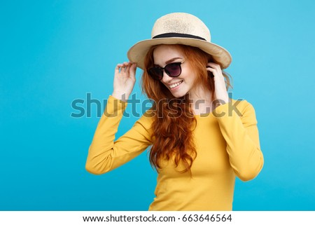 Close up Portrait young beautiful attractive redhair girl smiling looking at camera. Isolated on Blue Pastel Background. Copy space. #663646564