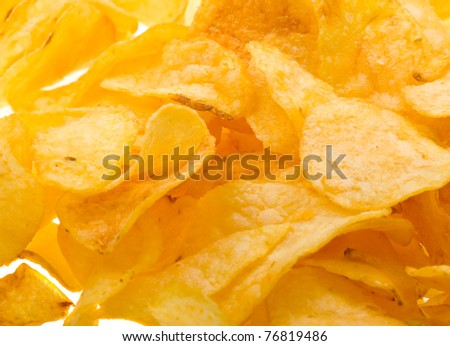 Close-up potato chips to background