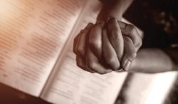 Close up prayer's hands folded pray in church, Pastor pray to God with BIBLE, top view with blank copy space