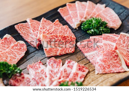 Close-up Premium Rare Slices many parts of Wagyu A5 beef with high-marbled texture on stone plate served for Yakiniku (Grilled Meat).