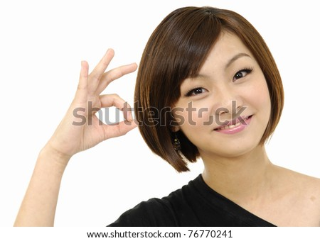 Close up Pretty young woman doing the ok sign