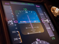 Close up Primary flight information display in modern commercial aircraft during cruise at altitude 35000 feet with auto pilot engagement