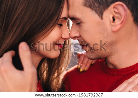 close-up profile of a guy and girl. guy and girl closed eyes.
