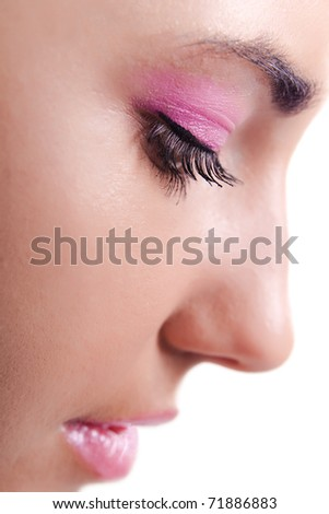 Close up profile of Caucasian young woman with makeup