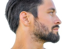 Close up profile portrait of healthy man with black hair, strong features, looking straight ahead