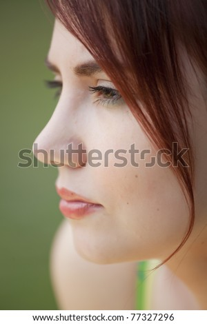 close-up profile portrait of sad young woman