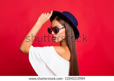 Close-up profile side view portrait of exquisite charming attractive tender sweet lovely straight-haired lady in white off-the-shoulders top touching hat look isolated over red background #1204213984