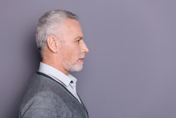 Close-up profile side view portrait of his he nice attractive serious content business shark wearing casual formal-wear copyspace isolated over gray pastel background