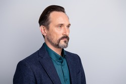 Close-up profile side view portrait of his he nice attractive serious content middle age man wearing formalwear employment after 40s isolated over light white gray pastel color background