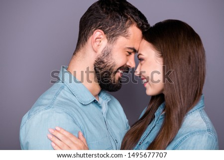 Close-up profile side view portrait of two her she his he nice attractive charming lovely affectionate careful sweet cheerful cheery person embracing cuddling isolated over gray pastel background