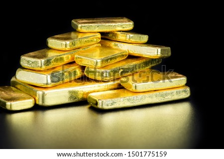 close up pure gold bar ingot put on the black color with bokeh surface background represent the business and finance concept idea, Real gold bars background