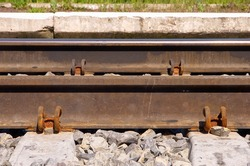 Close-up railway track background. Side view.