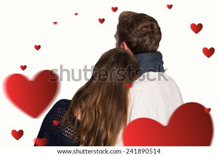 Close up rear view of romantic couple against hearts