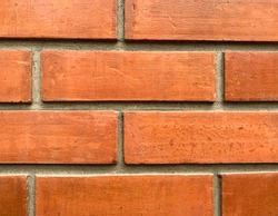 Close up Red brick cement wall.
