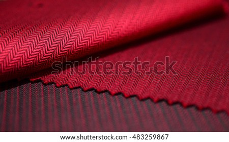 close up red fabric of shirt, photo shoot by depth of field for object #483259867