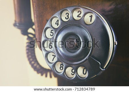 Close-up retro phone dial-plate. Horizontal indoors shot.