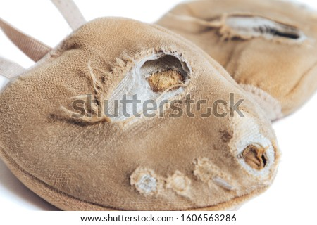 Close-up rhythmic gymnastics toe shoes very worn isolated on white background. Heavy training, heavy loads before the Olympics