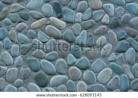 Close up rock pebbles texture surface - Shutterstock ID 628093145