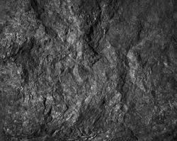Close up rocks. Dark Stone texture.