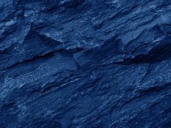 Close up rocks. Dark Stone texture. Blue rock.