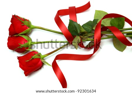 close up roses and red ribbon on white.