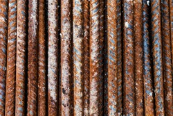 close up rustic steel bar or steel reinforcement bar in construction site, steel rods bars can used for reinforced concrete. construction background and texture.