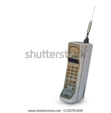 Close up rustic vintage mobile phone isolated on white background