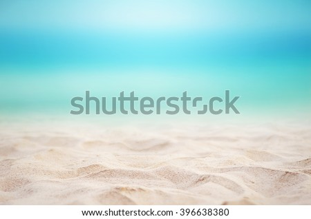 Close up sand with blurred sea sky background, summer day, copy space or for product. #396638380