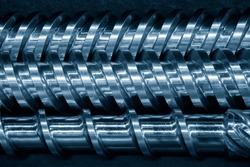 Close-up scene of injection machine screw spare parts.  the injection machine manufacturing process concept.