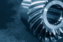 Close up scene of pinion gear spare part of differential system. The gear part manufacturing concept in light blue scene.