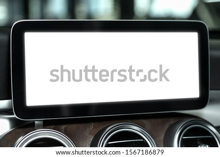 Close-up screen with a white background for your design on the control panel of a modern car. Mocap for advertising in the multimedia panel #1567186879