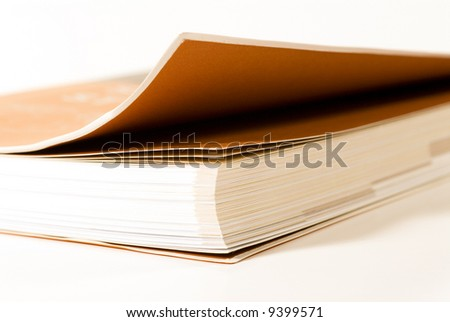 Close-up selective shot of a book with a slightly opened cover