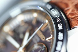 close up shallow focus Time zone cities code on luxury world time  watch bezel, PAR paris.