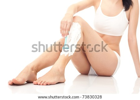 close up, shaving woman's legs, isolated on white
