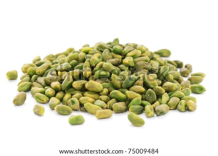 Close up shelled unsalted pistachios on white background