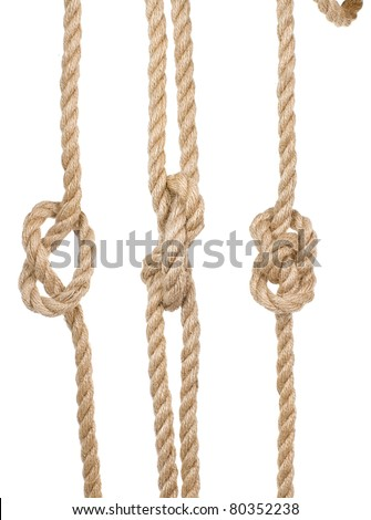 close up ship ropes with a knot isolated on white background - stock photo