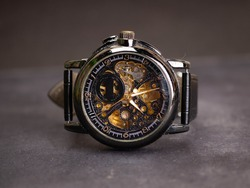 Close up shoot of black skeleton automatic watch. Captured on a dark mood style